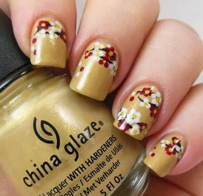 Golden nails with red and white petals