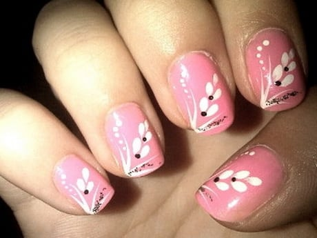 Nail styles with pink enamel and white petal flowers with black dots