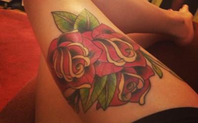 Tatuajes para mujeres en la pierna Rosa