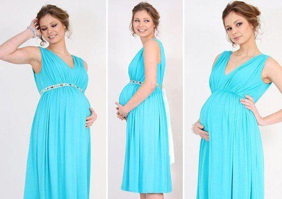 8e1102d09 Este es un vestido con un claro ejemplo de estampado floreado de color gris  y blanco en encaje con un moño sobre la panza de embarazada
